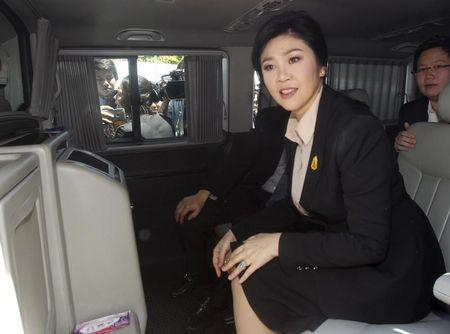 Ousted former Thai Prime Minister Yingluck Shinawatra sits in a van as she leaves the Supreme court in Bangkok, Thailand, May 19, 2015.  REUTERS/Chaiwat Subprasom