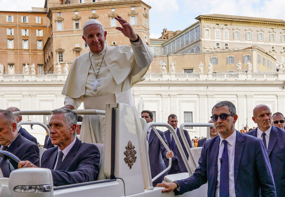 Pope Francis, flanked by newly appointed Vatican head of security Gianluca Gauzzi Broccoletti, bottom right, leaves at the end of his weekly general audience, in St.Peter's Square, at the Vatican, Wednesday, Oct. 16, 2019. (AP Photo/Andrew Medichini)
