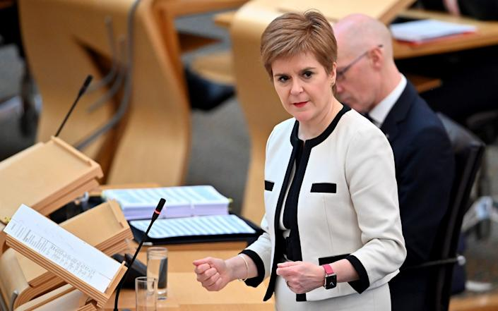 First Minister Nicola Sturgeon during First Minister's Questions at the Scottish Parliament, Edinburgh. - Jeff J Mitchell/PA