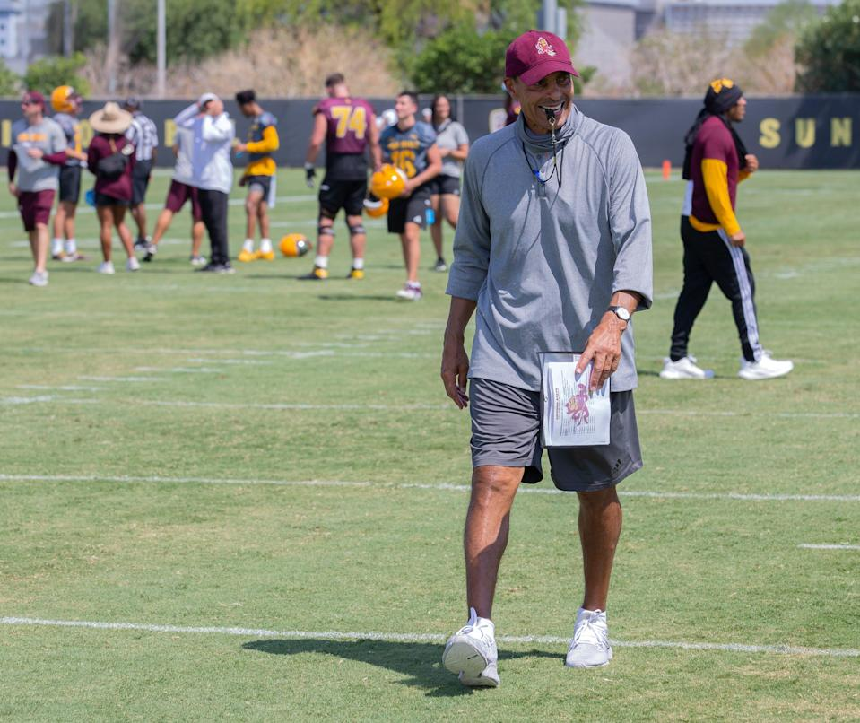 Arizona State University head coach Herm Edwards walks on the field with a whistle in his mouth during a team practice at the Bill Kajikawa Football Practice Field in Tempe on August 5.
