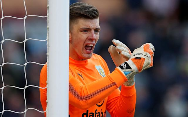 "Nick Pope has come a long way since his days as a college student playing part-time in the Isthmian League. Yet even then, he was tipped for big things. If he carries on at his current rate of progress, the Burnley goalkeeper might yet go to the World Cup. When he left Bury Town to join Charlton in 2011, the non-league club's manager Richard Wilkins told him that he would be playing Premier League football within five years. The prediction was only just out – it took six. Pope did not forget that forecast, texting Wilkins after making his first Premier League start for Burnley at Liverpool in September. The 25-year-old, promoted after Tom Heaton dislocated a shoulder, has since grabbed his chance. England manager Gareth Southgate was at Turf Moor as Pope made an outstanding second-half save to deny Southampton substitute Josh Sims. Southgate is approaching a World Cup unsure of who his three goalkeepers should be. Joe Hart and Fraser Forster cannot get into their club sides, while Stoke's Jack Butland made a dreadful error at Leicester on Saturday. Everton's Jordan Pickford may well be first choice in Russia, but Pope is worth a chance too, according to Burnley forward Ashley Barnes. ""Yes, 100 per cent,"" Barnes said. ""Nick Pope has been our player of the season. He deserves to be on that next level, but of course that's not our decision to make."" Arguably the biggest threat to Pope's international ambitions might be at club level. Heaton is approaching full fitness again. While Pope is thriving, Burnley's season has stalled. Barnes headed in from close range, but Manolo Gabbiadini swept in an equaliser. That lifted Southampton out of the relegation zone, but form remains a worry at St Mary's. ""I don't think there's a negative atmosphere,"" argued midfielder James Ward-Prowse. ""I think everybody's just frustrated at maybe our lack of wins. It's at times like this that everyone needs to be united."""