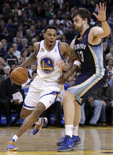 Golden State Warriors' Brandon Rush (4) drives past Memphis Grizzlies' Marc Gasol (33) during the first half of an NBA basketball game Wednesday, March 7, 2012, in Oakland, Calif. (AP Photo/Ben Margot)