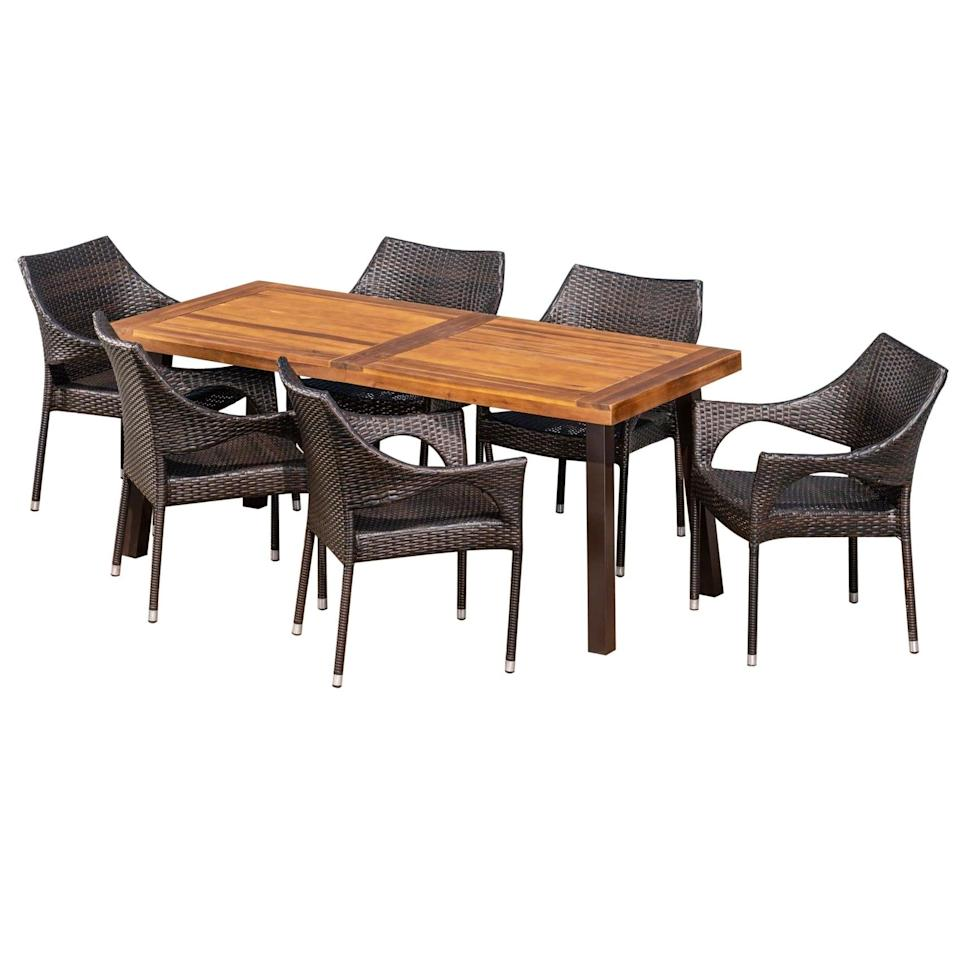 <p>We love the mix of wicker and wood on the <span>Piper Acacia and Wicker Dining Set</span> ($800).</p>