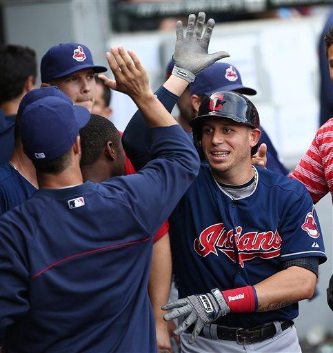 Cleveland Indians' Asdrubal Cabrera is all smiles after scoring the lead run on Nick Swisher's hit in the eighth inning as the Indians beat the Chicago White Sox 4-3 in a baseball game in Chicago, Saturday, June 29, 2013. (AP Photo/Charles Cherney)
