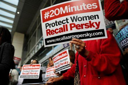 Activists hold signs calling for the removal of Judge Aaron Persky from the bench after his controversial sentencing in the Stanford rape case, in San Francisco, California