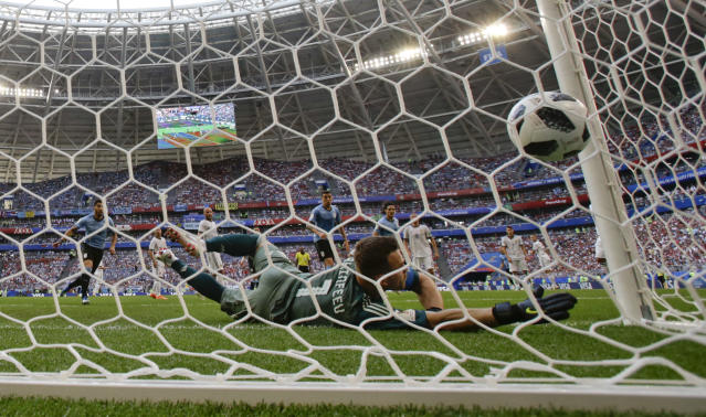 Russia goalkeeper Igor Akinfeev fails a block as Uruguay scores their side' second goal during the group A match between Uruguay and Russia at the 2018 soccer World Cup at the Samara Arena in Samara, Russia, Monday, June 25, 2018. (AP Photo/Rebecca Blackwell)