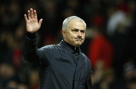 Manchester United manager Jose Mourinho waves to fans after the game