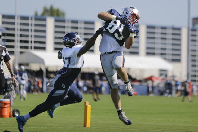 New England Patriots tight end Ryan Izzo (85) catches a pass as he is defended by Tennessee Titans defensive back JoJo Tillery (47) during a combined NFL football training camp Thursday, Aug. 15, 2019, in Nashville, Tenn. (AP Photo/Mark Humphrey)