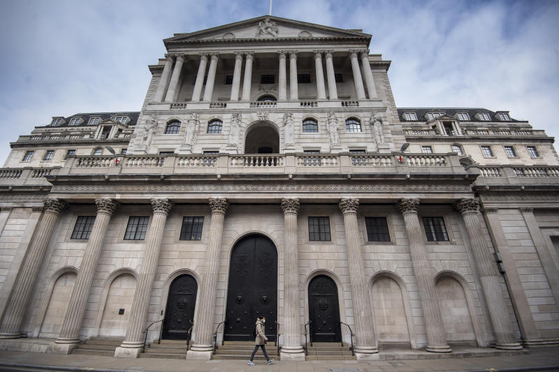 A man in a face mask walks past the Bank of England in the City of London as the UK continues in lockdown to help curb the spread of the coronavirus. (Photo by Victoria Jones/PA Images via Getty Images)