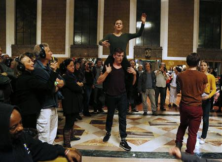 """Members of the L.A. Dance Project perform the opera """"Invisible Cities"""" at the Amtrak's Union Station in Los Angeles November 15, 2013. REUTERS/Fred Prouser"""