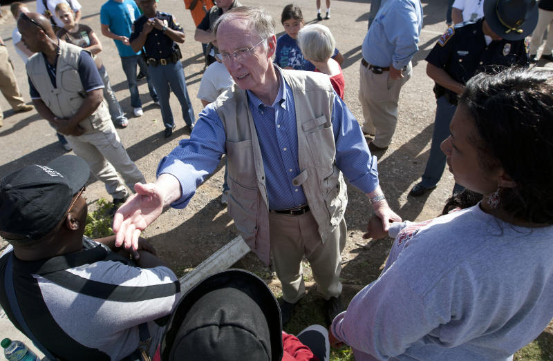 In this April 28, 2011 photo, Alabama Gov. Robert Bentley visits with residents in Tuscaloosa, Ala., who lost their homes in a tornado strike. A spawn of deadly tornadoes hit the state on Bentley's 100th day in office. (AP Photo/Dave Martin)