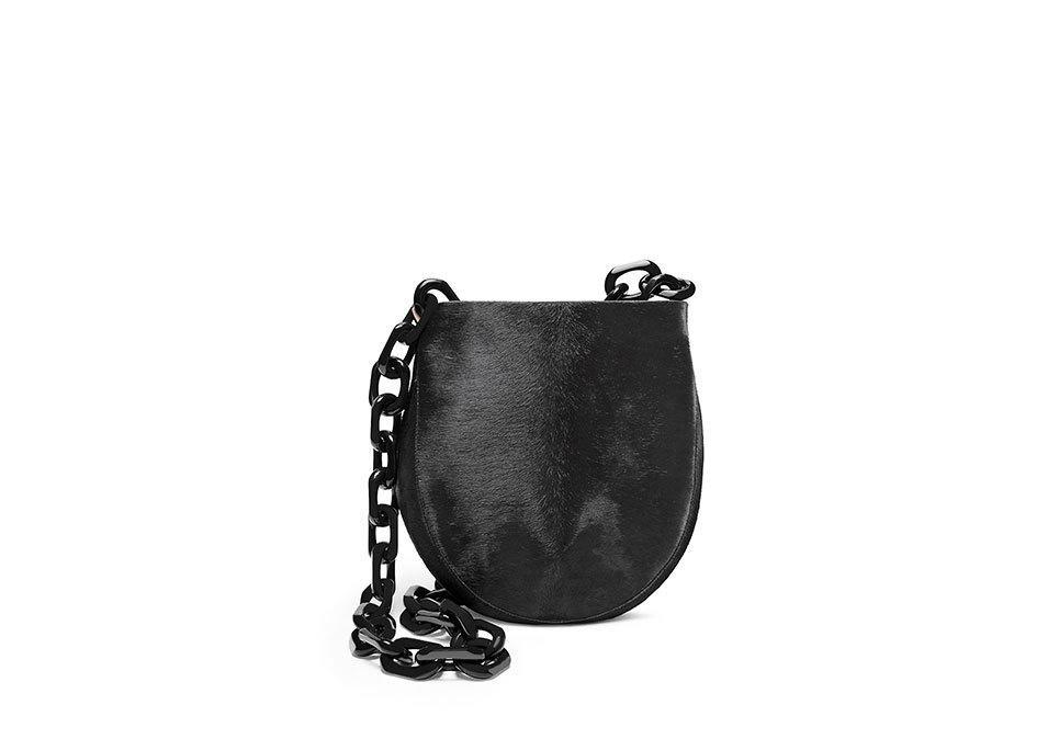 "<p>Calvin Klein Haircalf Sling Bag with Oversized Resin Chain, $1,118, <a href=""http://www.calvinklein.com/shop/en/ck/38860038?CS_003=44258774&CS_010=00883733687805"" rel=""nofollow noopener"" target=""_blank"" data-ylk=""slk:calvinklein.com"" class=""link rapid-noclick-resp"">calvinklein.com</a></p>"