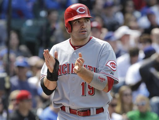 Cincinnati Reds' Joey Votto celebrates after scoring on a sacrifice fly hit by Todd Frazier during the eighth inning of a baseball game against the Chicago Cubs in Chicago, Saturday, May 4, 2013. The Reds won 6-4. (AP Photo/Nam Y. Huh)