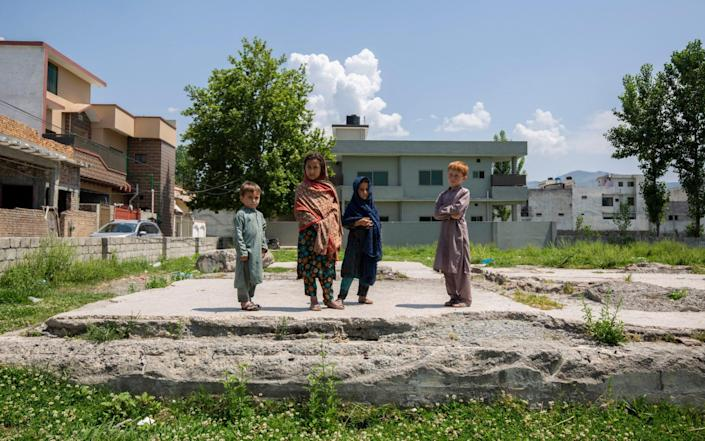 Children play where Osama Bin Laden's compound was situated - Saiyna Bashir for the Telegraph
