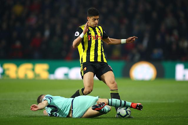 Adam Masina of Watford is tackled by Shkodran Mustafi