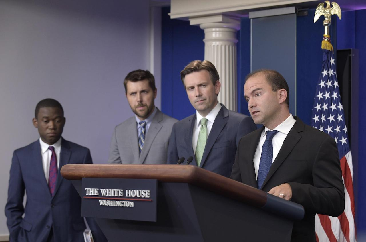 National Security Adviser for Strategic Communications Ben Rhodes, right, speaks during the daily briefing at the White House in Washington, Monday, Aug. 29, 2016. He is joined by White House press secretary Josh Earnest, second from right, Senior Adviser to the President Brian Deese, second from left, and Deputy National Security Adviser for International Economics Wally Adeyemo, to discuss President Obama's upcoming trip to China, Laos, Midway Island and Hawaii. (AP Photo/Susan Walsh)