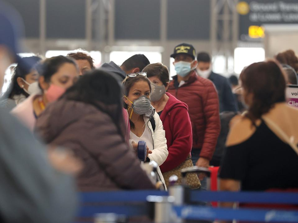 Passengers wait to check in at Tom Bradley international terminal at LAX airport, as the global outbreak of the coronavirus disease (COVID-19) continues, in Los Angeles, California, U.S., November 23, 2020.
