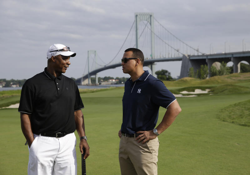 FILE- In this July 6, 2015 file photo, New York Yankee's Alex Rodriguez, right, talks with former baseball player Darryl Strawberry during a fundraiser at the Trump Golf Links at Ferry Point in the Bronx borough of New York. President Donald Trump's company posted annual losses at his golf course in the Bronx for the first time since it opened four years ago as expenses rose, greens fees barely budged and the opening of a clubhouse was delayed. (AP Photo/Seth Wenig, File)