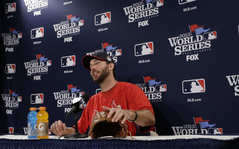 St. Louis Cardinals starting pitcher Adam Wainwright answers a question during a news conference Tuesday, Oct. 22, 2013, in Boston. Wainwright is scheduled to start against the Boston Reds Sox in Game 1 of baseball's World Series on Wednesday. (AP Photo/David J. Phillip)
