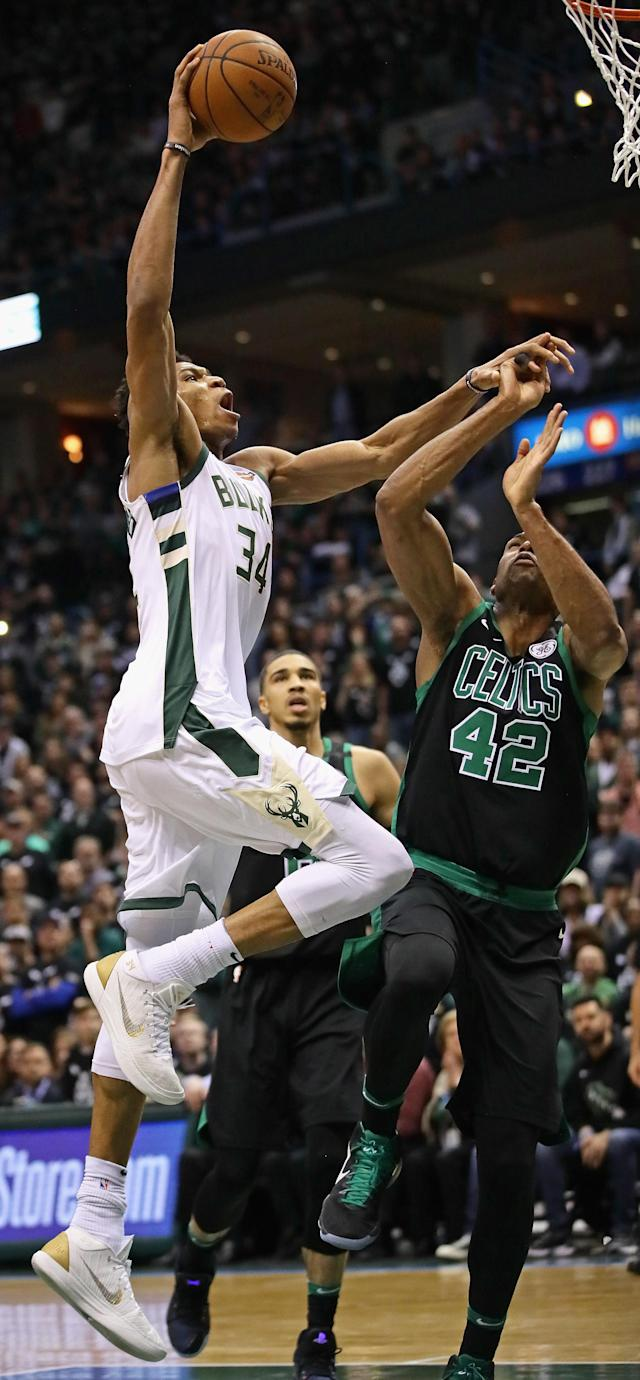 MILWAUKEE, WI - APRIL 22: Giannis Antetokounmpo #34 of the Milwaukee Bucks goes up for a dunk over Al Horford #42 of the Boston Celtics during Game Four of Round One of the 2018 NBA Playoffs at the Bradley Center on April 22, 2018 in Milwaukee, Wisconsin. The Bucks defeated the Celtics 104-102. (Photo by Jonathan Daniel/Getty Images)