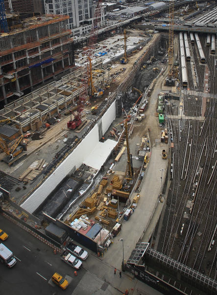 This photo made Thursday April 17, 2014, shows ongoing construction of a rail tunnel, center, at the Hudson Yards redevelopment site on Manhattan's west side in New York. Amtrak is constructing an 800-foot-long concrete box inside the project to preserve space for a tunnel from Newark to New York City that would allow it to double rail capacity across the Hudson River. (AP Photo/Bebeto Matthews)