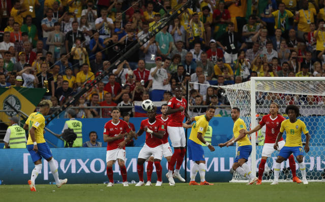 Brazil's Neymar, left, kicks a free kick during the group E match between Brazil and Switzerland at the 2018 soccer World Cup in the Rostov Arena in Rostov-on-Don, Russia, Sunday, June 17, 2018. (AP Photo/Darko Vojinovic)