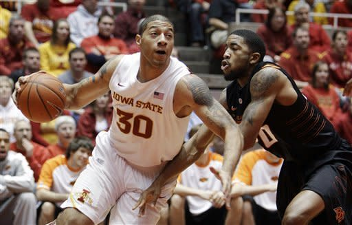 Iowa State forward Royce White (30) drives to the basket around Oklahoma State forward Michael Cobbins during the first half of an NCAA college basketball game, Wednesday, Jan. 18, 2012, in Ames, Iowa. (AP Photo/Charlie Neibergall)