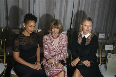 Vogue editor Anna Wintour (C) sits with tennis player Maria Sharapova (R) and singer Alicia Keys before a presentation of the Jason Wu Spring/Summer 2014 collection during New York Fashion Week September 6, 2013. REUTERS/Lucas Jackson