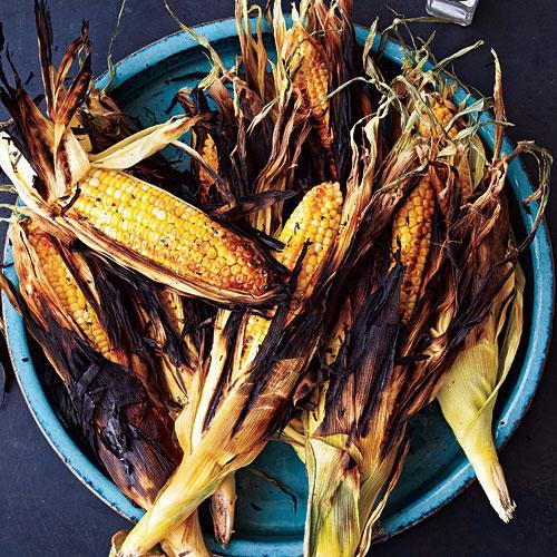 """<p>Grilled in its husk, the corn takes on a wonderful, lightly charred flavor while its sugars caramelize and intensify. Soaking in salted water lightly seasons the corn and helps keep it moist as it grills. Then, since the silks have been removed, just peel and enjoy.</p> <p> <a rel=""""nofollow noopener"""" href=""""http://www.myrecipes.com/recipe/grilled-corn-on-cob"""" target=""""_blank"""" data-ylk=""""slk:View Recipe: Grilled Corn on the Cob"""" class=""""link rapid-noclick-resp"""">View Recipe: Grilled Corn on the Cob</a></p>"""
