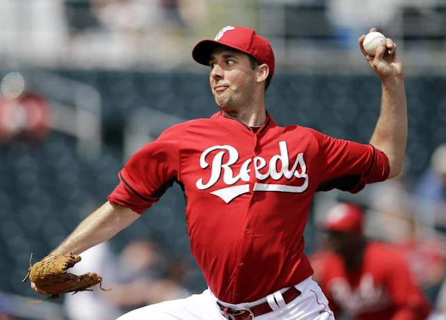 Cincinnati Reds starting pitcher Jeff Francis delivers against the Texas Rangers in the first inning of a spring exhibition baseball game Thursday, March 20, 2014, in Goodyear, Ariz. (AP Photo/Mark Duncan)