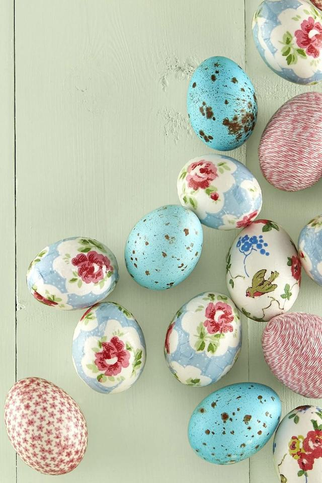 """<p><strong>Robin's Egg:  </strong>Mix two drops of green food coloring with standard blue egg dye, then dip the eggs and let dry. To create the speckles, use a fine-tipped paintbrush to splatter brown liquid ink.</p><p><strong>Paper Napkin Egg: </strong>Cut your favorite seasonal napkins into ½-inch-wide strips. Layer over eggs fully and paste with Mod Podge. Cut away any extra pieces and, once dry, seal with one more coat of Mod Podge.</p><p><strong>Twine Egg: </strong>Apply crafter's glue to the top of an egg and begin wrapping twine from the center into a tight circle. Work your way down the egg, adding glue and covering the entire surface with twine. Expect to use about 12 feet. <br><strong></strong></p><p><a rel=""""nofollow"""" href=""""https://www.amazon.com/ColorIt-Liquid-Watercolor-Bottle-Hearty/dp/B07BB5BJWP/"""">SHOP LIQUID INK</a></p>"""