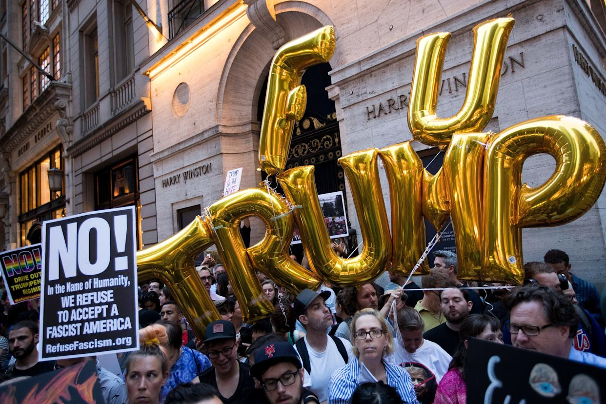 Protestors rally on Fifth Avenue near Trump Tower ahead of President Donald Trump's arrival, August 14, 2017 in New York City.