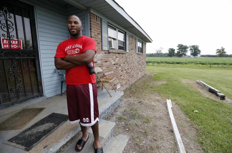 In this July 30, 2013 photograph, Perry Turner, 21, who lives across the road from the planned site for GreenTech Automotive's Tunica, Miss., assembly facility, said there was a lot of talk about the new car company years ago in the county of about 11,000 people south of Memphis, Tenn. But that talk has faded and Perry said there has been little activity at the site until recent months. (AP Photo/Rogelio V. Solis)