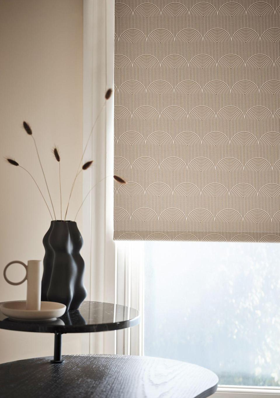 "<p>Bring tranquility and calmness to your room with Pendulum Demerara. This fabric features a stylish semi-circle retro design saturated in a dusky pink shade. Perfect for contemporary spaces, the geo pattern repeat gives an illusion of beautiful layers.<br></p><p>Better still, Pendulum Demerara is actually a blackout print, so if you want a great night's sleep, it's perfect for keeping the light out in your bedroom.</p><p><a class=""link rapid-noclick-resp"" href=""https://www.hillarys.co.uk/products/pendulum-demerara-roller-blind/"" rel=""nofollow noopener"" target=""_blank"" data-ylk=""slk:Order a sample and request an appointment"">Order a sample and request an appointment</a><strong><br><br>Like this article? <a href=""https://hearst.emsecure.net/optiext/cr.aspx?ID=DR9UY9ko5HvLAHeexA2ngSL3t49WvQXSjQZAAXe9gg0Rhtz8pxOWix3TXd_WRbE3fnbQEBkC%2BEWZDx"" rel=""nofollow noopener"" target=""_blank"" data-ylk=""slk:Sign up to our newsletter"" class=""link rapid-noclick-resp"">Sign up to our newsletter</a> to get more articles like this delivered straight to your inbox.</strong></p><p><a class=""link rapid-noclick-resp"" href=""https://hearst.emsecure.net/optiext/cr.aspx?ID=DR9UY9ko5HvLAHeexA2ngSL3t49WvQXSjQZAAXe9gg0Rhtz8pxOWix3TXd_WRbE3fnbQEBkC%2BEWZDx"" rel=""nofollow noopener"" target=""_blank"" data-ylk=""slk:SIGN UP"">SIGN UP</a></p><p>Love what you're reading? Enjoy <a href=""https://go.redirectingat.com?id=127X1599956&url=https%3A%2F%2Fwww.hearstmagazines.co.uk%2Fhb%2Fhouse-beautiful-magazine-subscription-website&sref=https%3A%2F%2Fwww.housebeautiful.com%2Fuk%2Fhouse-beautiful-collections%2Fg35979144%2Fhillarys-roller-blinds-collection%2F"" rel=""nofollow noopener"" target=""_blank"" data-ylk=""slk:House Beautiful magazine"" class=""link rapid-noclick-resp"">House Beautiful magazine</a> delivered straight to your door every month with Free UK delivery. Buy direct from the publisher for the lowest price and never miss an issue!</p><p><a class=""link rapid-noclick-resp"" href=""https://go.redirectingat.com?id=127X1599956&url=https%3A%2F%2Fwww.hearstmagazines.co.uk%2Fhb%2Fhouse-beautiful-magazine-subscription-website&sref=https%3A%2F%2Fwww.housebeautiful.com%2Fuk%2Fhouse-beautiful-collections%2Fg35979144%2Fhillarys-roller-blinds-collection%2F"" rel=""nofollow noopener"" target=""_blank"" data-ylk=""slk:SUBSCRIBE"">SUBSCRIBE</a></p>"