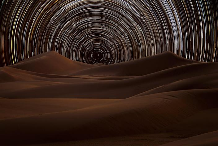 "<span class=""caption"">Star trails in the desert.</span> <span class=""attribution""><a class=""link rapid-noclick-resp"" href=""https://www.gettyimages.com/detail/photo/star-trail-in-the-desert-riyadh-saudi-arabia-royalty-free-image/936327752?adppopup=true&uiloc=thumbnail_similar_images_adp"" rel=""nofollow noopener"" target=""_blank"" data-ylk=""slk:TARIQ_M_1 / Getty Images"">TARIQ_M_1 / Getty Images</a></span>"