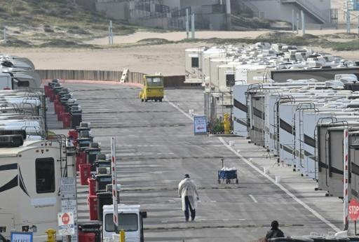 Medical staff walk among the roughly 100 beachside mobile homes