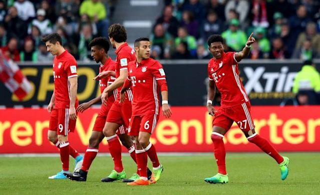 "<a class=""link rapid-noclick-resp"" href=""/soccer/players/david-alaba"" data-ylk=""slk:David Alaba"">David Alaba</a> celebrates his opener. (Getty)"