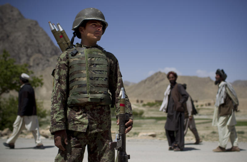 An Afghan National Army soldier carries his rockets while on patrol in Logar province, east Afghanistan, Thursday, May 17, 2012. NATO sits down May 20, 2012 in Chicago to prepare for the eventual withdrawal of international forces and the hand over of Afghanistan's security to the Afghan National Army. (AP Photo/Anja Niedringhaus)