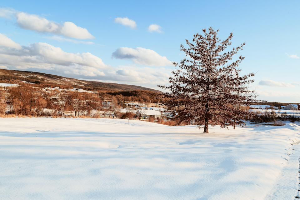 """New Yorkers have always flocked to the Catskills, but never more so than in 2020, when city-dwellers were eager to seek out fresh air and more space. There are plenty of reasons to visit in the winter, too. There's superb cross-country skiing and snowshoeing: Plattekill Mountain, for example, features almost 40 different trails and can even be booked out by a single group for the ultimate private adventure. There's also Hunter Mountain, which offers 100 percent snowmaking to guarantee terrific conditions no matter the weather—the Jägerberg Beer Hall at its base is a cheery après-ski spot, featuring New York state–made German-style beers and homemade spaetzle. Luxury spa <a href=""""https://www.theaurum.com/"""" rel=""""nofollow noopener"""" target=""""_blank"""" data-ylk=""""slk:The Aurum"""" class=""""link rapid-noclick-resp"""">The Aurum</a> at Mount Tremper is slated to open fall 2021; alternatively book one of the Tower Cottages at the Roxbury at Stratton Falls, which opened in 2020, <a href=""""https://www.cntraveler.com/story/what-its-like-to-open-a-new-boutique-hotel-during-a-pandemic?mbid=synd_yahoo_rss"""" rel=""""nofollow noopener"""" target=""""_blank"""" data-ylk=""""slk:just weeks before the pandemic struck."""" class=""""link rapid-noclick-resp"""">just weeks before the pandemic struck.</a> New York state's pandemic protocols are based on where <a href=""""https://coronavirus.health.ny.gov/covid-19-travel-advisory"""" rel=""""nofollow noopener"""" target=""""_blank"""" data-ylk=""""slk:visitors are coming from"""" class=""""link rapid-noclick-resp"""">visitors are coming from</a>."""