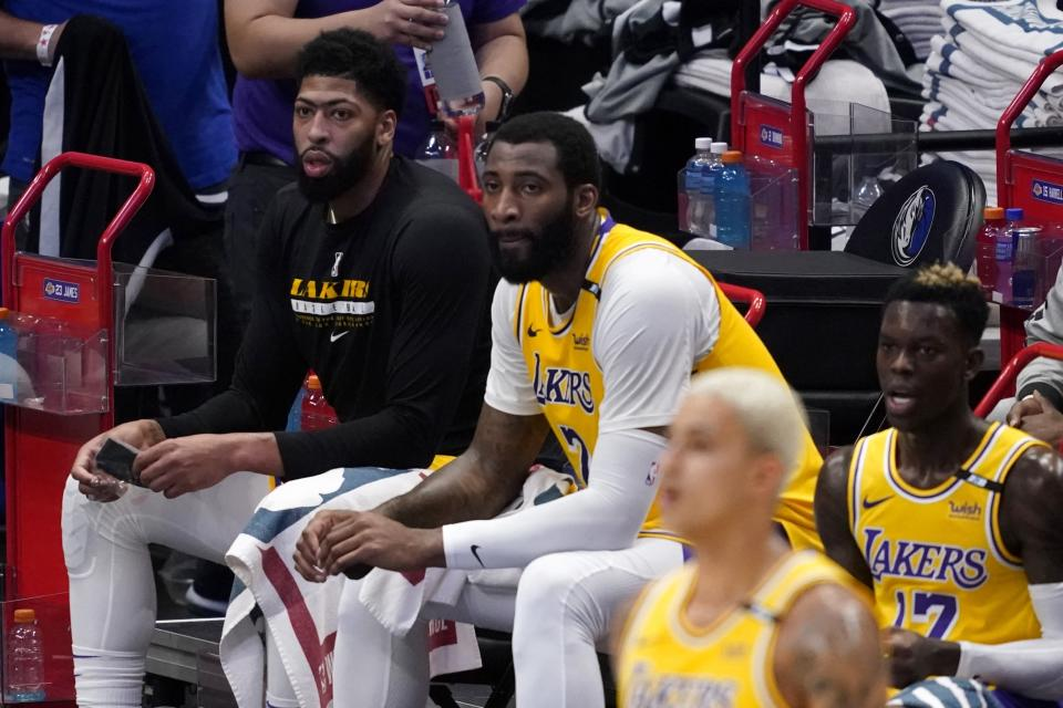 Los Angeles Lakers' Anthony Davis, Ben McLemore, Kyle Kuzma, front, and Dennis Schroeder watch play in the first half of an NBA basketball game against the Dallas Mavericks in Dallas, Thursday, April 22, 2021. (AP Photo/Tony Gutierrez)