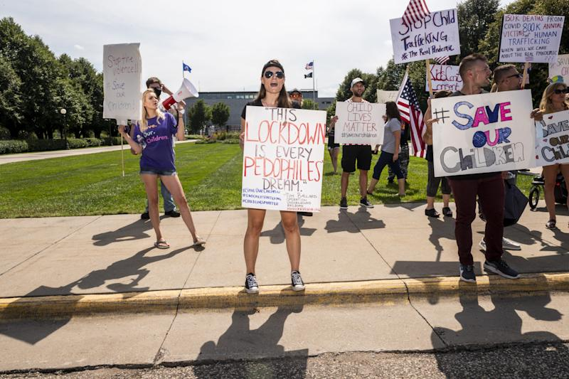 Save the Children demonstrators rally outside the Capitol building Aug. 22 in St Paul, Minnesota. Some rallies around the country to decry human trafficking and pedophilia have been linked to social media accounts promoting QAnon conspiracy theories.