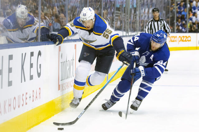 St. Louis Blues defenseman Colton Parayko (55) battles for the puck with Toronto Maple Leafs defenseman Morgan Rielly (44) during first-period NHL hockey game action in Toronto, Monday, Oct. 7, 2019. (Chris Young/The Canadian Press via AP)