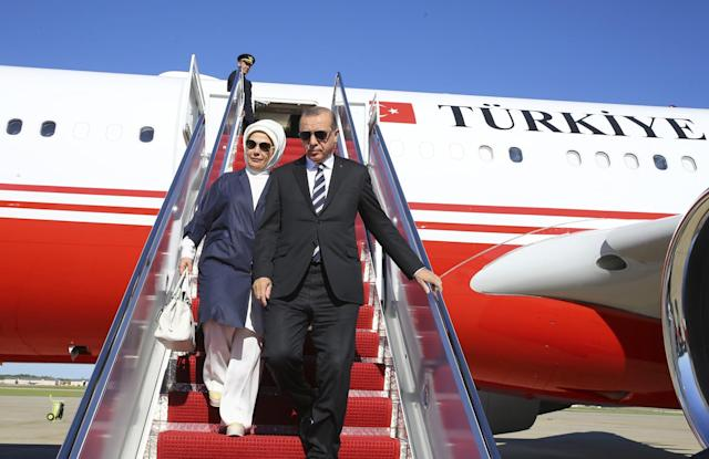 <p>Turkey's President Recep Tayyip Erdogan and his wife Emine disembark from a plane after arriving in Washington, Monday, May 15, 2017. Erdogan is scheduled to meet U.S. President Donald Trump on Tuesday for talks expected to center on the friction between the two NATO allies over a U.S. decision to arm Syrian Kurdish fighters considered as terrorists by Turkey. (Presidency Press Service/Pool photo via AP) </p>