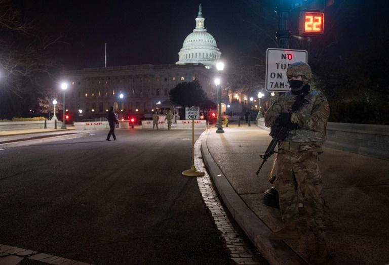 US National Guard soldiers protected the grounds of the US Capitol days after supporters of outgoing President Donald Trump stormed the building during certification of Joe Biden's election victory
