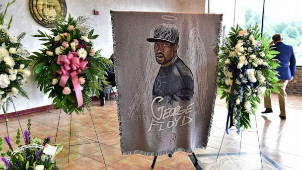 PHOTO: A picture of George Floyd and flowers are set up for a memorial service for Floyd, June 6, 2020, in Raeford, N.C. (Ed Clemente/AP)