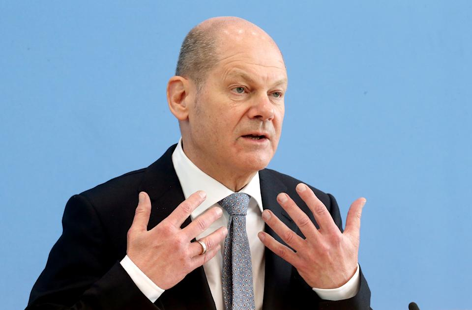 24 March 2021, Berlin: Olaf Scholz (SPD), Federal Minister of Finance, presents the key figures of the federal budget 2022 and the financial plan until 2025 before the Federal Press Conference. Previously, the politician commented on the admission of the Chancellor to have made a mistake in the implementation of the Corona measures and around the Easter holidays. Photo: Wolfgang Kumm/dpa (Photo by Wolfgang Kumm/picture alliance via Getty Images)