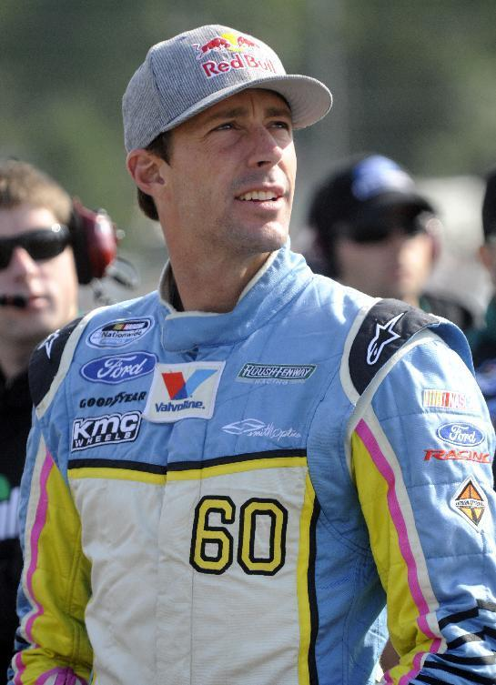 Travis Pastrana on pit road during qualifying for the Nationwide Children's Hospital 200 at Mid-Ohio Sports Car Course Saturday, Aug. 17, 2013 in Lexington, OH. (AP Photo/Tom E. Puskar)