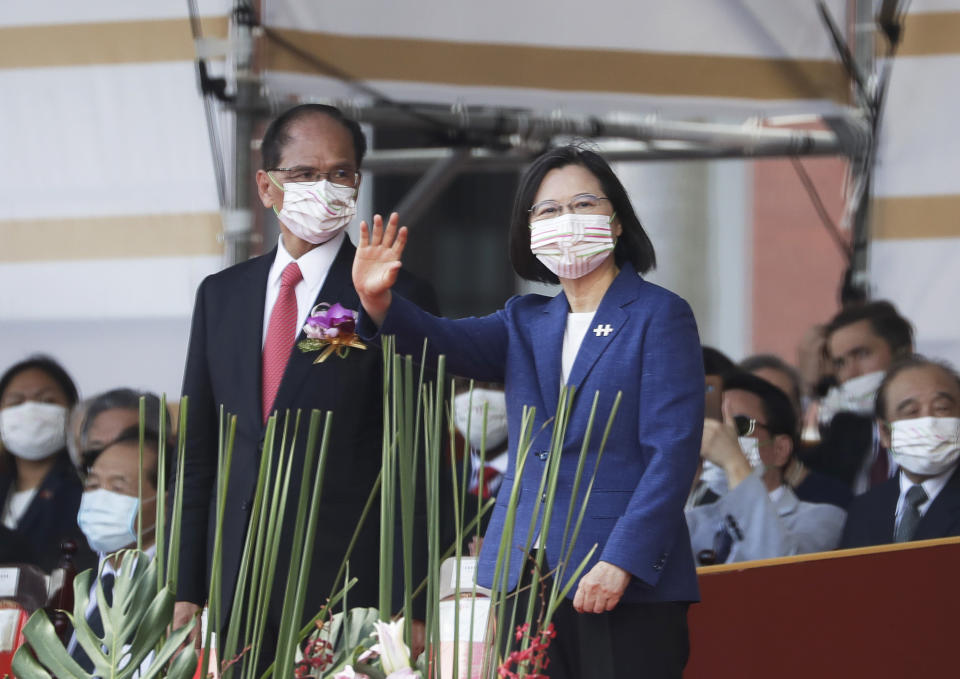 Taiwan's President Tsai Ing-wen, right, and Yu Shyi-kun, speaker of the Legislative Yuan, cheer with audience during National Day celebrations in front of the Presidential Building in Taipei, Taiwan, Sunday, Oct. 10, 2021. (AP Photo/Chiang Ying-ying)