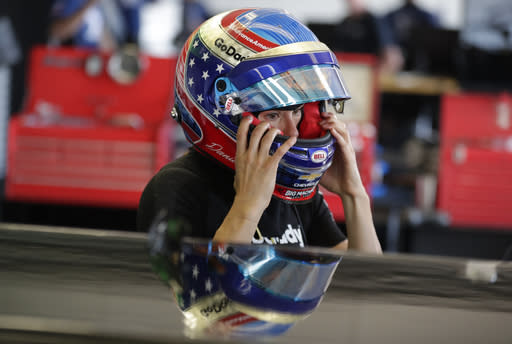 Danica Patrick checks the fit on a helmet in her garage on the opening day of practice for the Indy 500 auto race at Indianapolis Motor Speedway in Indianapolis, Tuesday, May 15, 2018. (AP Photo/Michael Conroy)