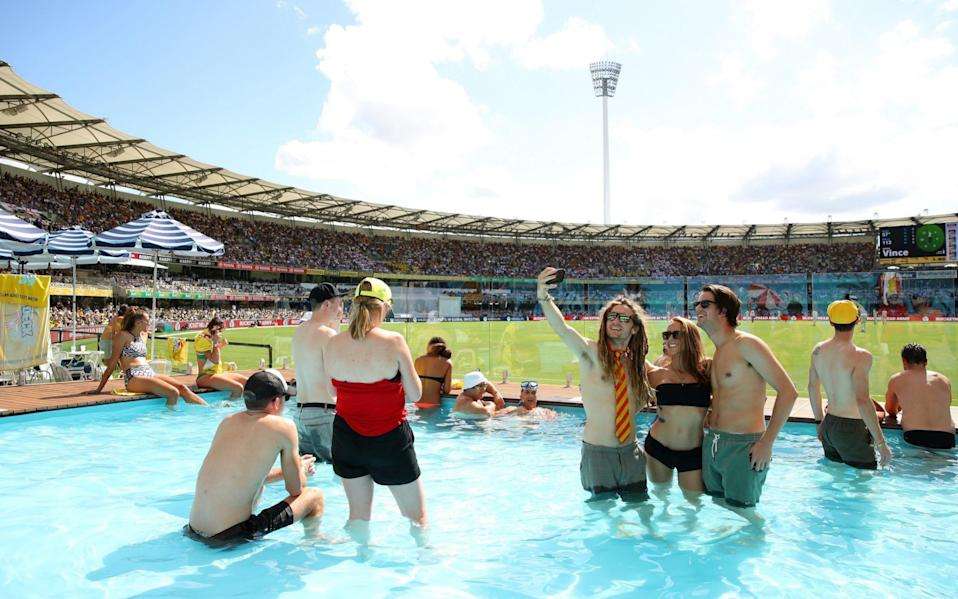 Fans cool off in the pool at the Gabba Pool Deck during day one of the First Test Match of the 2017/18 Ashes Series between Australia and England at The Gabba on November 23, 2017 in Brisbane, Australia - Cameron Spencer/Getty Images
